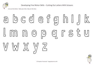 cutting out letters with scissors